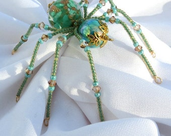 Christmas Spider Ornament in Teal and Gold Folk Art Tale of Tinsel and Garland