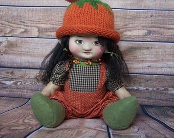Punkin', a cloth and clay Autumn, Fall, or Halloween pumpkin art doll by Jan Conwell