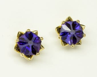 Hanami Earrings! Incredible floral stud earrings in 18k yellow gold set with conflict free lab created purple sapphire hanami gemstones