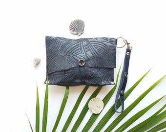Navy embossed leather wristlet