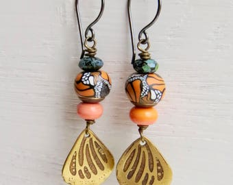 Mariposa - handmade artisan bead earrings in orange, charcoal black and bronze with butterfly and wing detail  - Songbead UK, narrative
