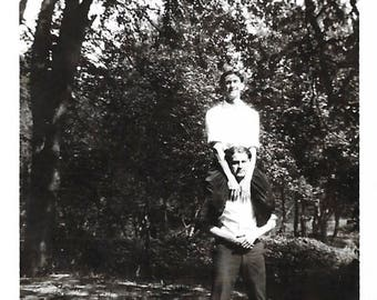 "Vintage Snapshot ""He Ain't Heavy"" Piggyback Ride Teenage Boy On Young Man's Shoulders Found Vernacular Photo"