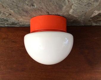 Seventies ceiling lamp, flush mount ceiling light fixture, wall lamp; mushroom shaped white opal glass; orange plastic ceiling fixture