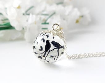Birds and branches - silver plated tiny resin orb - nature inspired jewellery handmade in the UK