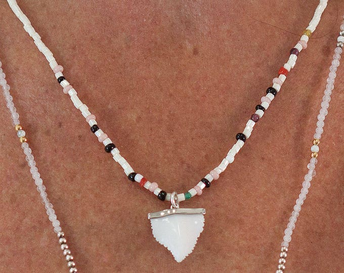 Necklace with pearls and a shark tooth pendant