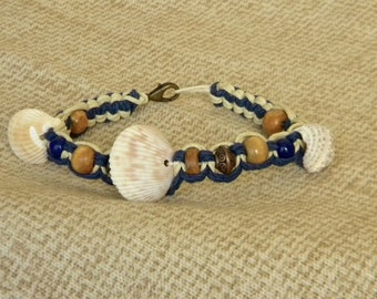 Macrame bracelet in navy blue and natural with seashells, wood, bronze