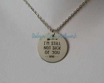 I'm Still Not Sick Of You xoxo Engraved Stainless Steel Disc Necklace on Silver Chain or Black Faux Suede Cord with Heart & Arrow. Cute Gift