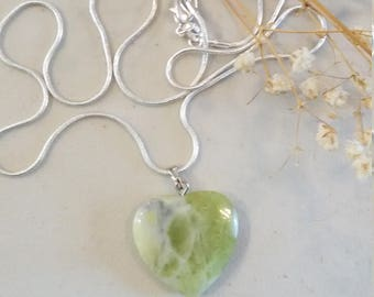 Heart shaped agate pendant on sterling silver chain.