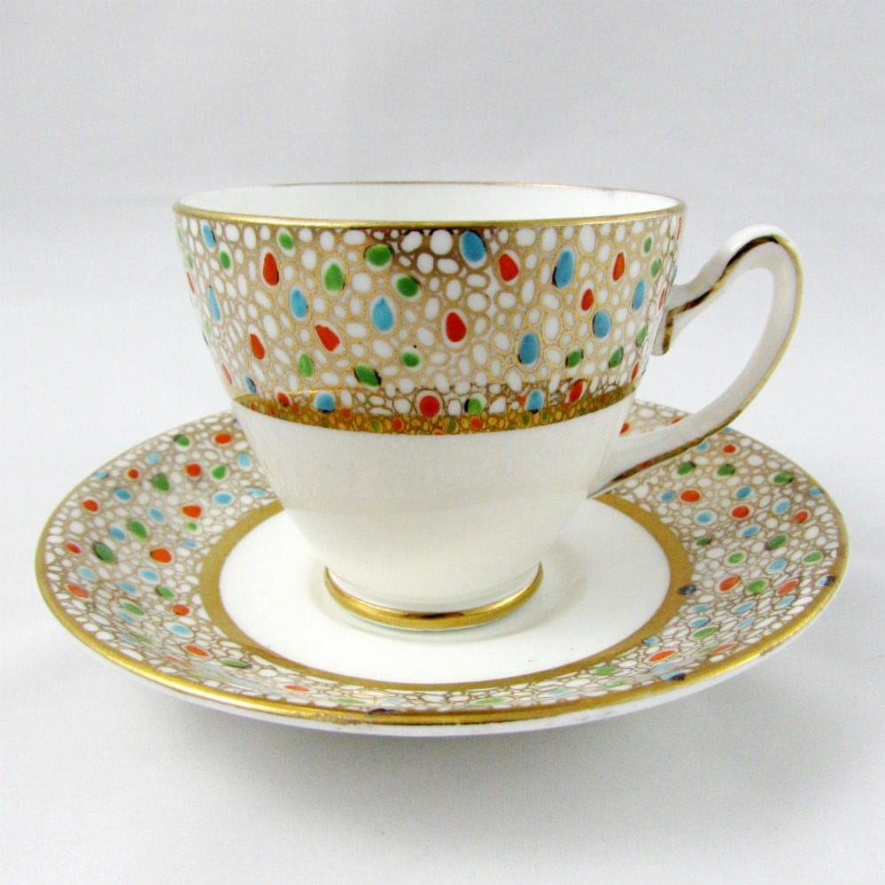 Vintage tea cup and saucer gold with polka dots for Gold polka dot china