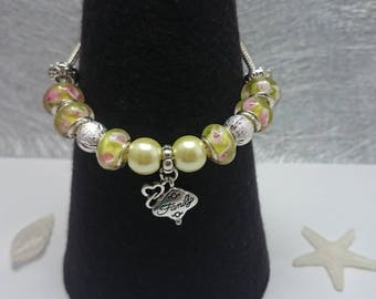Charm's yellow charm bracelet with Family ref 172