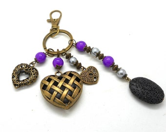 A scent! bronze bag charm, hearts, purple and gray tone