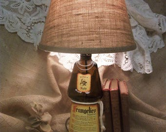 Upcycled bottle, electric lamp.