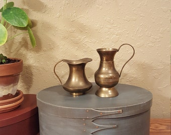 Set of small vintage brass pitchers.  Two small weathered brass pitchers.  Boho brass pitchers.