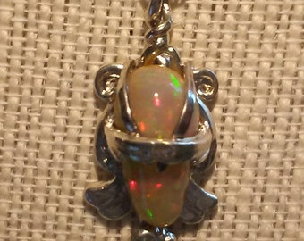 """7.8 carat natural """"golden opal"""" necklace pendant with beautiful fire"""