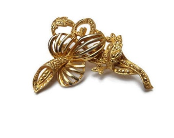 KIGU marked stylised orchid brooch, gold tone and marcasite