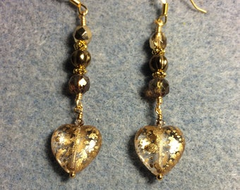 Sparkly gold Czech glass heart bead dangle earrings adorned with gold Czech glass beads.