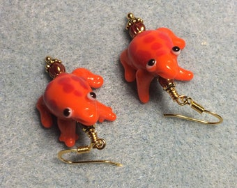 Red lampwork frog bead earrings adorned with red Czech glass beads.