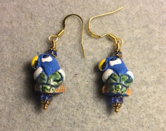 Small blue, green, and yellow ceramic parrot bead earrings adorned with blue Chinese crystal beads.