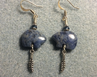 Blue sodalite gemstone Zuni bear fetish bead earrings adorned with tiny silver feather charms and blue crystal beads.