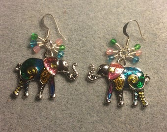 Colorful enamel elephant charm earrings adorned with tiny dangling turquoise, pink, and green Czech glass beads.