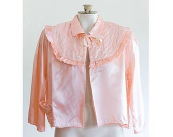 1950s pink satin bed jacket