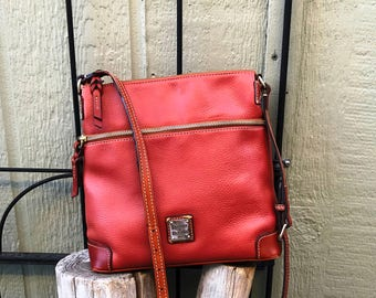 Gently used brown Dooney & Bourke pebbled all weather leather crossbody bag with double belted adjustable strap, boho, bohemian, hippy