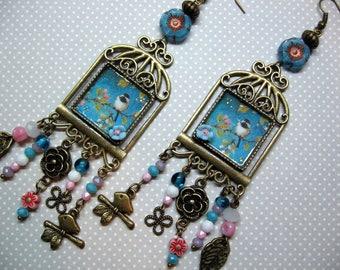 birdcage bird, flowers, pearls earrings