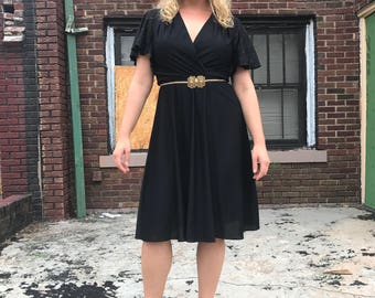 Beautiful flowy black 60s dress