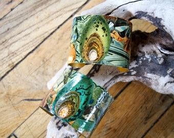 "Large ""Alien"" brass bracelet with collage of antique prints"