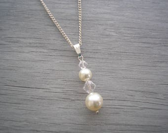 Stunning Pendant Necklace made with Swarovski 8 & 6mm Pearls and 6 and 4mm Crystals on a fine silver plated chain