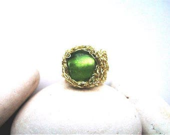 Gold crochet wire ring with green murano bead