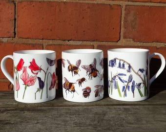 China Mugs with Bee and Flower designs illustrated by Alice Draws The Line. Choose from Sweet Peas, Bluebells and Bees on these china mugs