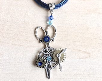 "Blue steampunk ""scissors"" necklace with COGS, gears and Swarovski Crystal"