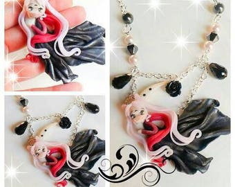 handmade polymer clay necklace inspired by lady black lying on the Moon