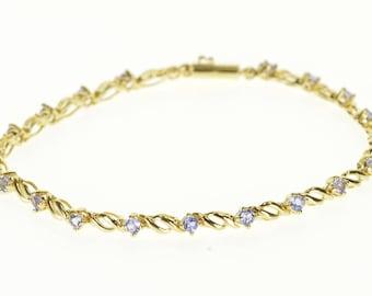 "14k Tanzanite Encrusted Wavy Link Tennis Bracelet Gold 7.25"""
