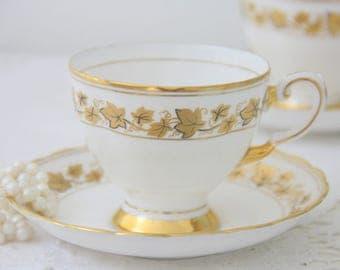Elegant Vintage Tuscan Cup and Saucer, Gold Ivy Leaf Decor, England