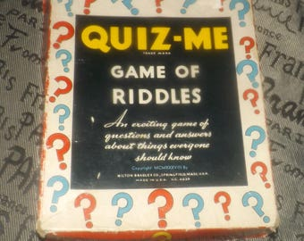 Quite vintage (c.1938) Quiz-Me Game of Riddles published by Milton Bradley.  Made in the USA. Game No. 4928.