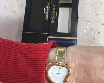 Authentic Yves Saint Laurent heart face gold tone watch,serial number 21655 Genuine unused in box,new battery ,YSL France vintage 1990's