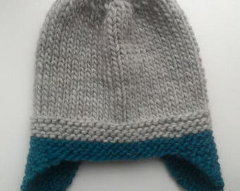 Knitted winter cap with ears 46-48, height 19 cm