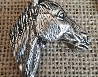 Silver plated horse head brooch