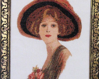 Picture embroidered with beads The girl in the hat