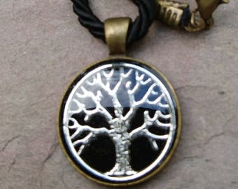 resin embedded silver plated 'tree of life' set in bronze alloy setting
