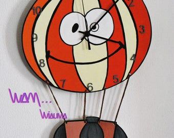 clock balloon with a beautiful smile