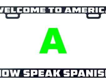 Welcome to America now speak Spanish lettering language country funny license plate frame tag holder decal sticker send note
