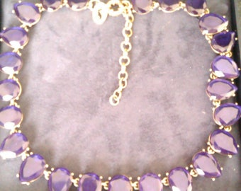 gold coloured necklace blue/purple stones