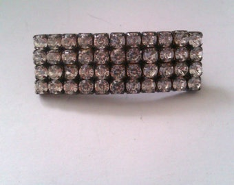 silver coloured 4 row diamante bar brooch