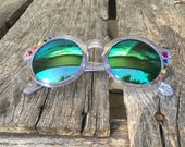 PRIDE Asymmetrical Embellished Round Sunglasses - Translucent Purple Frames, Purple-Green Reflective Lenses, with Rainbow Rhinestones