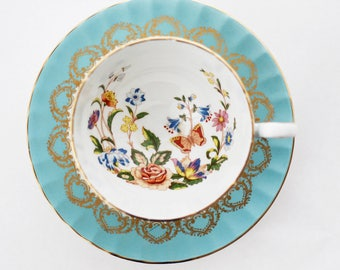 Aynsley England TEACUP and saucer, chinoiserie, bright colored flowers, butterflies, goldgilt trimming, goldgilt extorior, marked,  c1999