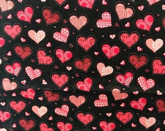 pink red heart glitter valentines day fabric on a black background novelty fabric