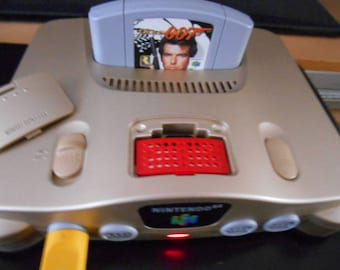 Gold Nintendo 64 N64 with Expansion Pak and Yellow Controller